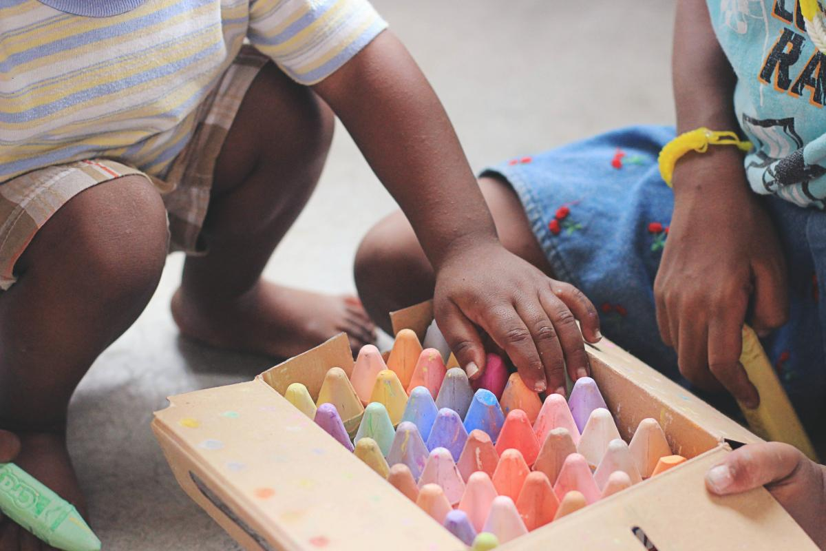 Kids playing with crayons